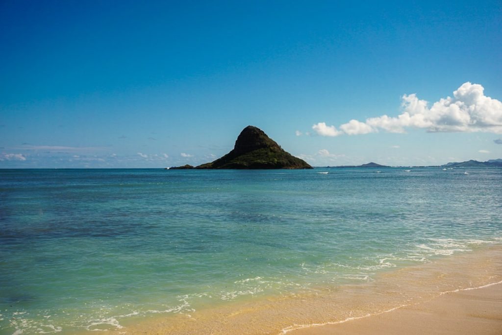 Mokoli'i Island, also known as Chinamen's Hat, off is the distance.