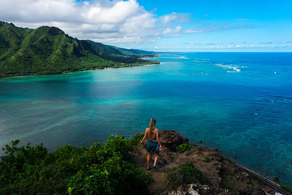 Woman walking to the tip of Crouching Lion lookout on Oahu