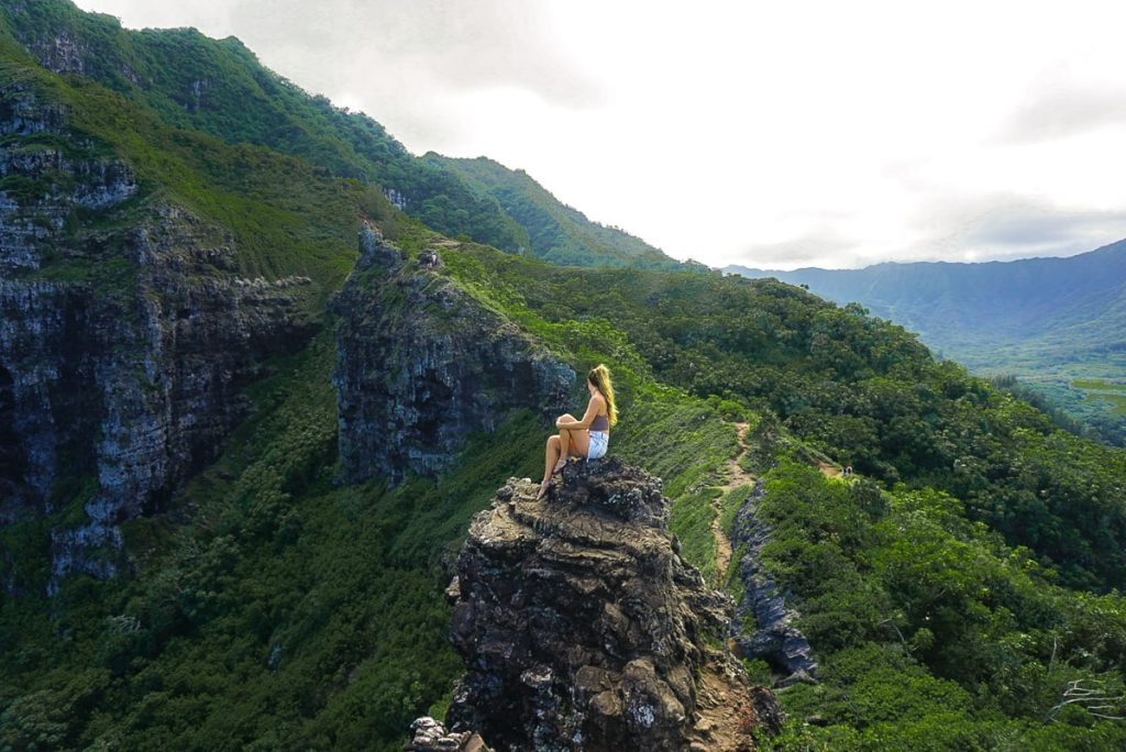 Woman sitting at the top of Crouching Lion hike on Oahu
