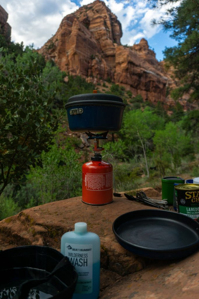 Cooking stove perched on a rock with mountain in the background