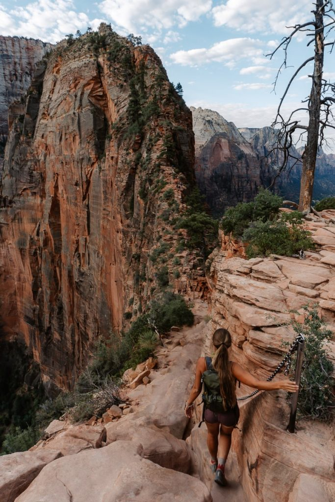 Girl hiking along the ridge of Angels Landing Trail