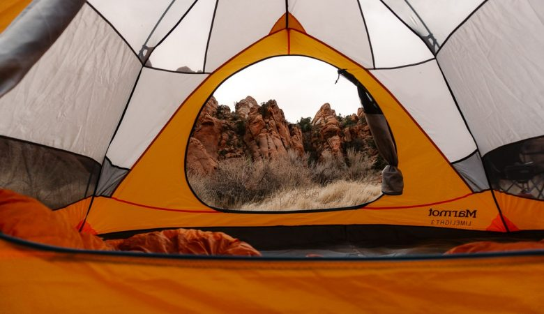 View from insde a tent looking out a red rocks