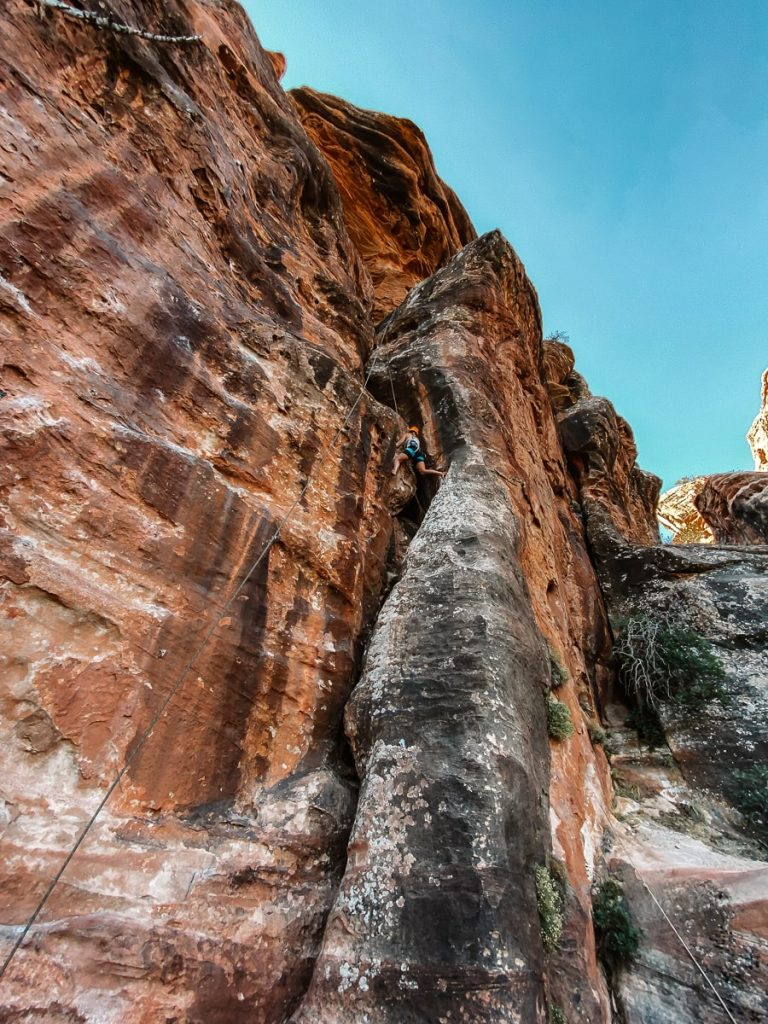 Man rock climbing in Zion National Park