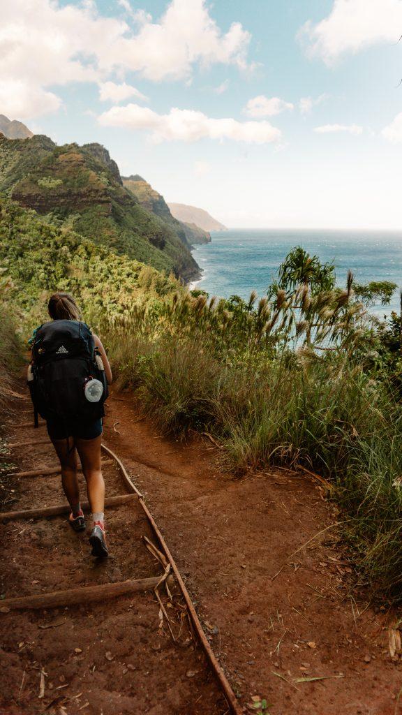 Woman walking on the Hanakāpīʻai Falls Trail