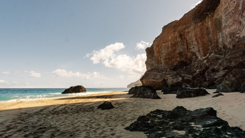 Beach with large rocks and cliffs