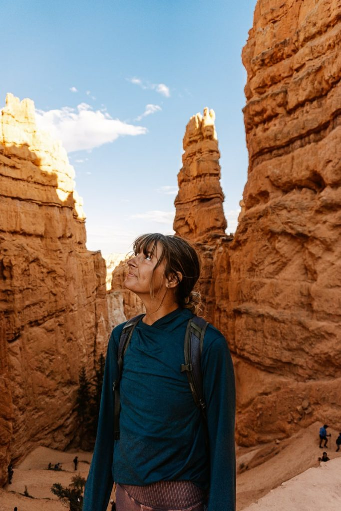 Hiker standing at the top of Wall Street on the Navajo Loop Trail